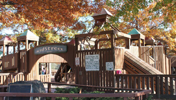 a photo of the entrance to kidstreet playground during fall