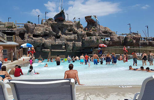 photo visitors enjoying the harbor wave pool at Breakwater Beach waterpark